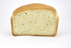 Το μισό από το άσπρο ψωμί με τα χορτάρια και τα καρυκεύματα Στοκ Φωτογραφία