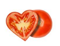 Το μισό των ντοματών υπό μορφή καρδιάς στοκ εικόνες