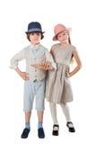 Το μοντέρνα αγόρι και το κορίτσι θέτουν στο στούντιο Στοκ εικόνα με δικαίωμα ελεύθερης χρήσης