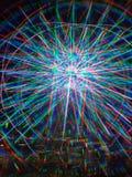 το μπλε των τρισδιάστατων πολύχρωμων οδηγήσεων φω'των το περιστέρι νησιών σφυρηλατεί τη ρόδα ferris στοκ φωτογραφία