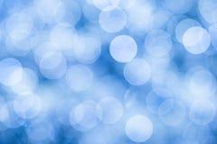 Το μπλε υπόβαθρο με το bokeh τα φω'τα Στοκ Φωτογραφίες