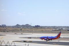 Το μπλε φαραγγιών χρωμάτισε boing-737, Phoenix, AZ Στοκ εικόνα με δικαίωμα ελεύθερης χρήσης