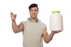 Το μυϊκό άτομο με τα πρωτεϊνικά βάζα στο λευκό Στοκ φωτογραφία με δικαίωμα ελεύθερης χρήσης