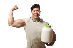 Το μυϊκό άτομο με τα πρωτεϊνικά βάζα στο λευκό Στοκ εικόνα με δικαίωμα ελεύθερης χρήσης