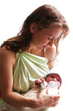 το μωρό ταΐζει τη μητέρα της ν Στοκ Εικόνα