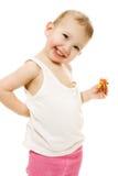 Το μωρό τρώει την καραμέλα σε μια άσπρη ανασκόπηση στοκ φωτογραφίες με δικαίωμα ελεύθερης χρήσης