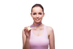 Το νέο θηλυκό με το χρυσό μετάλλιο νικητών που απομονώνεται στο λευκό Στοκ Εικόνες