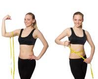 Το νέο κορίτσι με το εκατοστόμετρο να κάνει δίαιτα στην έννοια Στοκ Εικόνες