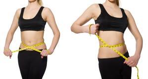 Το νέο κορίτσι με το εκατοστόμετρο να κάνει δίαιτα στην έννοια Στοκ εικόνες με δικαίωμα ελεύθερης χρήσης