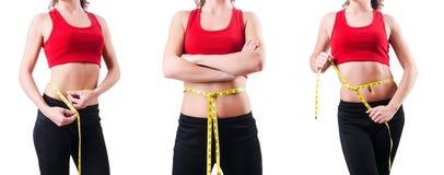 Το νέο κορίτσι με το εκατοστόμετρο να κάνει δίαιτα στην έννοια Στοκ Εικόνα