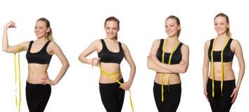 Το νέο κορίτσι με το εκατοστόμετρο να κάνει δίαιτα στην έννοια Στοκ Φωτογραφίες