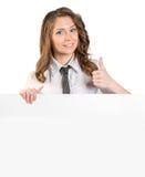 Το νέο κορίτσι σε έναν δεσμό που παρουσιάζει σημάδι φυλλομετρεί επάνω στοκ εικόνες με δικαίωμα ελεύθερης χρήσης