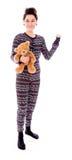 Το νέο κράτημα γυναικών teddy αντέχουν και η παρουσίαση χεριών της Στοκ Εικόνες