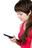 Το νέο όμορφο κορίτσι γράφει sms. απομονωμένος Στοκ εικόνες με δικαίωμα ελεύθερης χρήσης