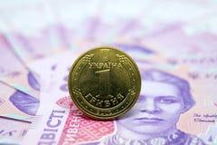 Το νόμισμα είναι ένα hryvnia στα πλαίσια του τραπεζογραμματίου εγγράφου Στοκ φωτογραφία με δικαίωμα ελεύθερης χρήσης