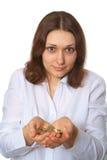 το νόμισμα κρατά τη γυναίκα Στοκ φωτογραφία με δικαίωμα ελεύθερης χρήσης