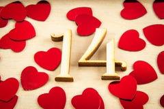 Το ξύλινο πλαίσιο με τους αριθμούς ένα και τέσσερα και καρδιές για ένα λευκό επιζητά Στοκ Εικόνες