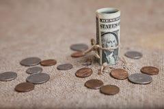 Το δολάριο, που δένεται με ένα σχοινί Στοκ Εικόνες