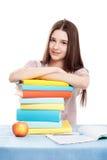 Το παιδί κοριτσιών στον πίνακα με τα βιβλία στοκ εικόνες με δικαίωμα ελεύθερης χρήσης