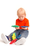 το παιδί κρατά τους γρίφο&ups Στοκ Εικόνες