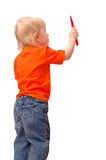 το παιδί σύρει το μολύβι Στοκ Εικόνες