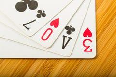 Το παιχνίδι καρτών πόκερ τακτοποιεί το κείμενο αγάπης Στοκ Φωτογραφία