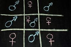 Άνδρα-γυναίκας τιποτένιοι και σταυροί Στοκ Εικόνες