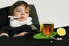 Το παιδί αρρώστησε, πυρετός, βήχας, runny μύτη Στοκ Εικόνες