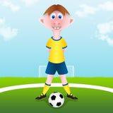 Το παιδί αρχίζει τον αγώνα ποδοσφαίρου Στοκ Φωτογραφίες