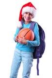 Το παιδί με το κόκκινες καπέλο και τη σφαίρα Άγιου Βασίλη Στοκ Εικόνες