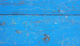 Το παλαιό αγροτικό ξύλινο κατασκευασμένο υπόβαθρο grunge με το μπλε χρώμα ράγισε το ξεπερασμένες χρώμα και τις γρατσουνιές στοκ εικόνες