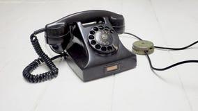 Το παλαιό τηλεφωνικό blackcolor καθορισμένο απομονώνει Στοκ Φωτογραφία