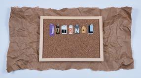 Το περιοδικό του Word στον πίνακα του Κορκ Στοκ Φωτογραφία