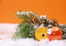 Το πορτοκάλι το υπόβαθρο Χριστουγέννων Στοκ Φωτογραφίες