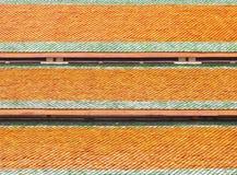 Το πορτοκαλί υπόβαθρο σύστασης στεγών Στοκ Εικόνα