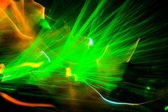 Το πράσινο λέιζερ παρουσιάζει σε ένα disco Στοκ Εικόνες
