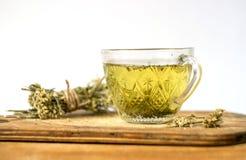 Το πράσινο τσάι με τα λουλούδια Στοκ Εικόνες