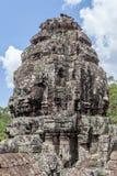 Το πρόσωπο πετρών καταστροφών bayon στην πύλη Angkor Wat, Siem συγκεντρώνει, Cambo Στοκ εικόνα με δικαίωμα ελεύθερης χρήσης