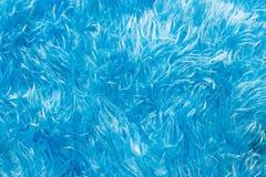 Το πόδι σκουπίζει το μπλε μαλλί στοκ φωτογραφία