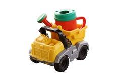 Το πλαστικό πότισμα μπορεί στο πίσω μέρος ενός αυτοκινήτου παιχνιδιών Στοκ φωτογραφία με δικαίωμα ελεύθερης χρήσης
