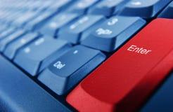 Το πληκτρολόγιο με το κόκκινο εισάγει το κουμπί Στοκ Φωτογραφίες