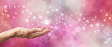 Το ροζ σπινθηρίσματος αποδείξεων δώρων ακτινοβολεί έμβλημα Bokeh Στοκ Φωτογραφία