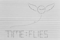Το ρολόι με τα φτερά που πηγαίνουν μακριά και το χρόνο πετά το κείμενο στον ψηφιακό συναγερμό ελεύθερη απεικόνιση δικαιώματος
