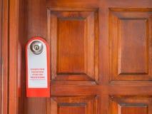 Το σημάδι στη λαβή πορτών δεν ενοχλεί Στοκ φωτογραφίες με δικαίωμα ελεύθερης χρήσης