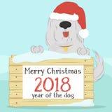 Το σκυλί στο καπέλο Άγιος Βασίλης που κρατά μια ξύλινη επιφάνεια με ένα πρότυπο για τα Χριστούγεννα επιθυμεί ελεύθερη απεικόνιση δικαιώματος