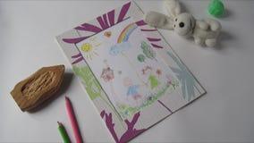 Το σχέδιο παιχνιδιών και των παιδιών εμφανίζεται σε έναν πίνακα απόθεμα βίντεο
