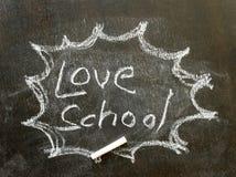 Το σχολείο αγάπης λέξης στο σημάδι φυσαλίδων Στοκ Φωτογραφία