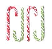 Το σύνολο καραμέλας Χριστουγέννων τέσσερα μπορεί στο άσπρο υπόβαθρο Στοκ Φωτογραφία