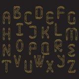 το σύνολο χρυσού ακτινοβολεί επιστολές Στοκ φωτογραφία με δικαίωμα ελεύθερης χρήσης