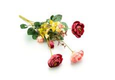 το τεχνητό λουλούδι ανασκόπησης απομόνωσε το λευκό Στοκ Φωτογραφίες